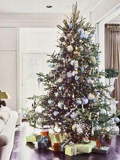 Christmas balls on tree in white stark room - love the blue
