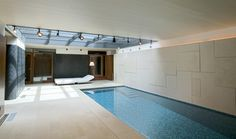Long, narrow pool in basement for swimming laps, relaxing, or having a good time.