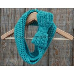 Handmade crochet infinity scarf, the Brittany, in turquoise with large bow detail from Divinedebris.com for $14.99
