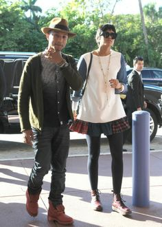 December Celeb Sightings Pharrell Williams and wife Helen Lasichanh visit the Art Basel in Miami.
