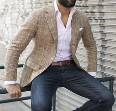 Go for a tan check blazer and navy blue jeans to achieve a dressy but not too…