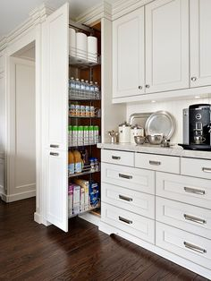 Pantry storage glides open for a complete view of all items. Wire shelving is adjustable to taller items such as cereal boxes to shorter juice boxes.