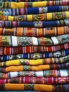 stacked blankets in Peruvian market