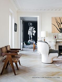 Modern in Paris would describe the interiors of this project by Marion Collard. Just look at all these amazing pieces.