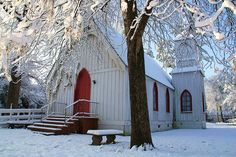 love the red door and the contrast with the snow.