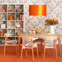 Tangerine modern dining room            Juicy orange tones combined with a pretty floral pattern create a vibrant dining room scheme. Teaming the orange with white and pale wood furniture stops the colour from overwhelming the look.