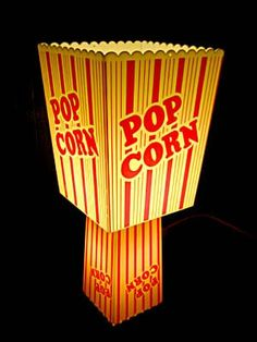 This table light has be transformed by re-useing 2 plastic popcorn containers. Perfect for your movie nights. There is a 15 watt bulb in the bottom and a 9