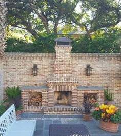 Since the front yard is the beach, the fireplace sitting area is located in the expansive side yard of this home!