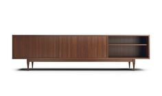 What makes the Simic credenza an unstoppable work of art isn't its gracious storage options, pre-cut media holes, or the fact that you can choose your favorite wood to create the perfect look for your home. The better-best part is the fact that it's built by hand to ensure it exceeds industry standards in every way. Using responsibly sourced, top-of-the-line materials, we build every element by hand to ensure that it becomes a lasting centerpiece in your home.