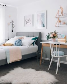 A subtle combo of light blue, teal, peach, + pink set the mood for chill, welcoming vibes.