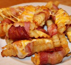 Bacon Wrapped Cheese Fries! Appetizer, party food. Fun to make, and DELICIOUS. Make them for football parties or any other excuse you can think of. Gluten Free ~ http://reallifedinner.com