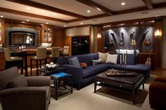Home| Cool Man Cave Ideas and Decor: Fancy Blue L Shaped Sofa With Classic Brown Coffee Table Also Guitar Wall Shelves Ideas In Man Cave Design