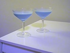 blue angel cocktails - 2 parts brandy or cognac, 1 part blue curacao, 1 part vanilla liqueur, 1 part cream (half and half) and a dash of lemon juice shaken and strained.