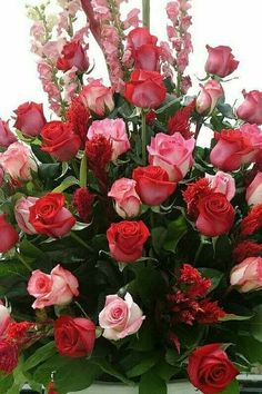 Pink roses and red roses floral arrangements