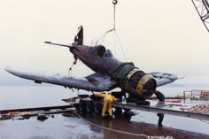 The Museum's Goodyear FG-1D Corsair being raised from Lake Washington in 1983 -- Image © Pete Wallingford