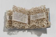 "Paper (2010).  Hanji, lokta, indigo, thread, poem by Joana Varawa. 3.25 x 2.75 x 1.25""."