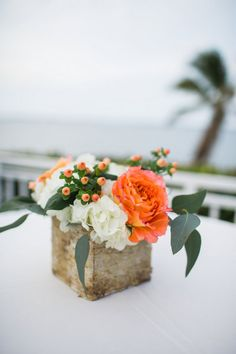 Rustic floral arrangement in a vintage wood vase created from hydrangea, eucalyptus, berries and roses. See this coral and green Vintage Spring Florida Wedding -Jessica Bordner Photography @jbpbrides here:  http://www.confettidaydreams.com/vintage-spring-florida-wedding/