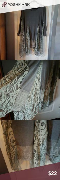 Grey tunic with lace Cute top. worn one time. said it was a XL but, fit much larger. maybe 2XL or more. weight is tshirt material and bottom is lace Tops Tunics