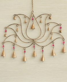 Wall Art from India! A lotus chime made with traditional bells is a wonderful way to add music to your life. Handmade by artisans in India and bedecked with bright pink beads for a splash of color. Indian Home Decor, Diy Home Decor, Indian Decoration, Suncatchers, Mobiles, Deco Boheme Chic, Buddha Wall Art, Pooja Room Design, Music Crafts