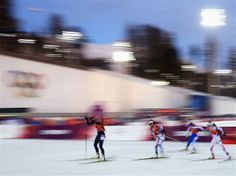Tora Berger of Norway leads the field in the 2 x 6 km Women + 2 x 7.5 km Men Mixed Relay. Sport: Biathlon. Sochi 2014 - Best of Day 13.