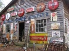 we used to slide down a hill in grandpa's pasture on one of those large round coca cola signs! Old General Stores, Old Country Stores, Coca Cola Addiction, Coca Cola Kitchen, Cocoa Cola, Always Coca Cola, Vintage Coke, Soda Fountain, Advertising Signs