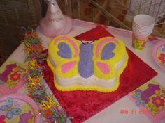 Buttercream iced butterfly cake to match decorations.