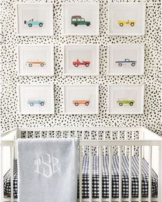 Nursery dotted wallpaper and car frame decoration