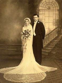 lovely bride and dapper groom - my guess would be from late 1930s to 1940s.