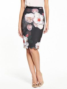 Ted Baker Laylie Chelsea Print Pencil Skirt Flourished with Ted Baker's famous florals, the Chelsea pencil skirt is a pretty addition to your occasion wardrobe. The bold blooms give your outfit a pop of colour, while the classic fitted silhouette and sweet scalloped trim add to the ladylike charm.Pair with a chic cami top and heels to parties and events.Material Content: 96% Polyester,4% ElastaneWashing Instructions: Machine WashableApprox length 24 insBack ZipScalloped hem lineLined