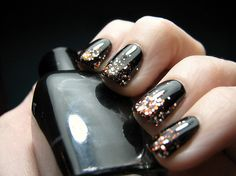 Black nails with metallic gradient (glitter looks to be copper, silver & gold - different sizes.) Maybe use a black JELLY!!! Great for NEW YEARS EVE!!!