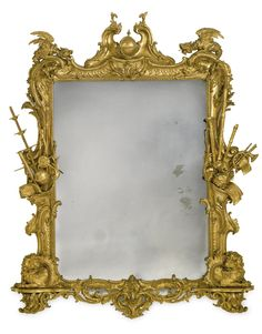A fine and rare George II giltwood picture frame in the manner of Thomas Chippendale mid-18th century the rectangular mirror plate surmounted by a scroll cresting centering a globe flanked by chimera, the sides with draftsmen and musical trophies, the lower portion with mythical beasts centering a mask. height 7 ft. 10 in; width 6 ft. 3 in. 239 cm; 185.4 cm