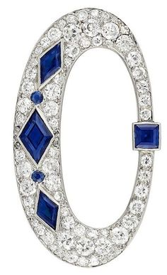 Art Deco Platinum, Diamond and Sapphire Brooch, Cartier. The openwork tapered oval brooch topped by one square-cut sapphire, accented by 3 diamond-shaped sapphires spaced by 2 round sapphires, set throughout with 66 old European and single-cut diamonds, and 4 rose-cut diamonds, circa 1920.