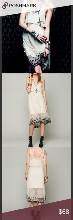 New Free People Intimately Southern Girl Lace Slip Style: 27334218 Color Code:  Sheer dotted mesh slip dress with cropped top layer that has ruffled trimming. Bottom hem has contrasting embroidered design. Best to be worn with an extra slip or seamless romper underneath for coverage, or to layering underneath some of your shorter dresses for a peek of sheer fabric at the bottom. Brand new without tags.   *100% Nylon *Hand Wash Cold *Import Free People Dresses