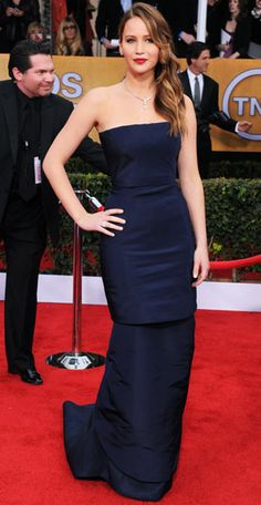 Jennifer Lawrence in a strapless navy Dior Haute Couture column. 2014