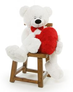 Surprise your sweetheart with a special Valentine's Day gift.  A giant teddy bear for Valentine's Day like Paw Mittens is perfect.  Paw is a giant white teddy bear that measures 52 inches in height.