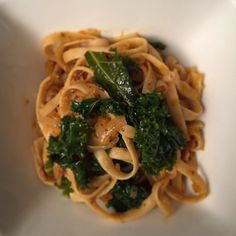 Caramelized onion butternut squash fettuccine with kale and crispy bacon. #bonappetit #nutfree #dairyfree