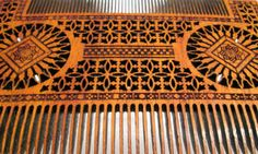 Combs based on design of the Italian wooden medieval combs by ZanoZa Workshop. Source: http://www.pinterest.com/pin/444589794438443770/ http://www.pinterest.com/pin/12173861468954683/ Exotic african wood - bilinga. Original size - 20cm x 14 cm.  https://www.facebook.com/media/set/?set=a.805858689452666.1073741880.260720530633154&type=1