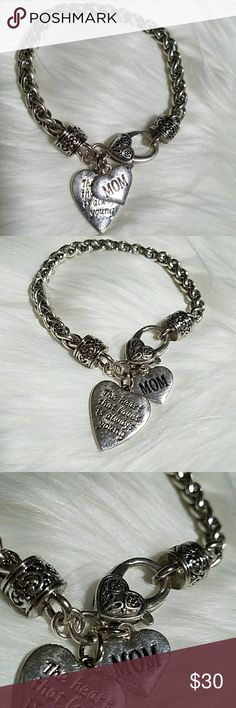 """MOM,The heart that loves is always young"""" bracelet Silver Bracelet with heart pendants and heart closure. Says """"MOM, The heart that loves is always young""""  8"""" length All measurements are approximately  Non Smoking and Pet Friendly Home Jewelry Bracelets"""