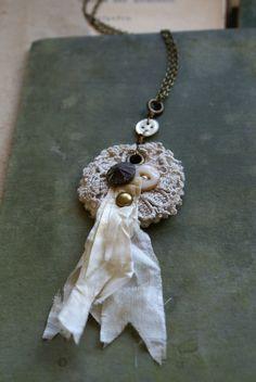 Mixed Media Fabric Rosette Pendant -- Handmade in Ireland. $30.00, via Etsy.