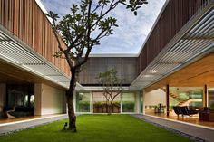 Located in Singapore, Enclosed Open House is a private residence designed by Wallflower Architecture + Design.