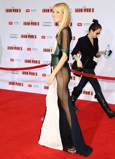 Gwyneth Paltrow flashes sidebutt at the Iron Man 3 premiere!