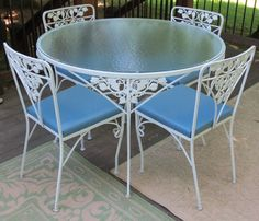Vintage Woodard Patio Dining Table with matching Chairs