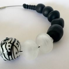 Large hollow glass beads. black white and clear beach glass big beads make this statement necklace. Lampwork. Comes in a handcrafted wooden gift box