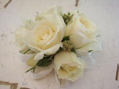 ivory mini roses wrist corsage for the mother and grandmothers to match fathers