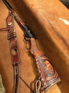 Custom made rifle slings, stock wraps, holsters canteens, cowboy shooting rigs and much more. Leather Rifle Sling, Leather Holster, Leather Tooling, Tooled Leather, Leather Pouch, Buffalo Brand, Cowboy Crafts, Rifle Accessories, Leather Working Patterns