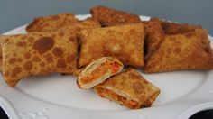 Portuguese Egg Rolls: I would saute the chourico, onions and peppers, but wouldn't add the cheese until ready to fill. You could take a spoonful of the chourico mixture add the cheese then wrap with egg roll wrapper! YUM!
