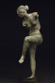 Bronze Aphrodite Figurine  Hellenistic - 200BC-100BC  Bronze  She is stooping to remove sandal