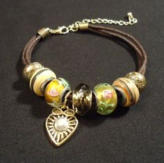'Beautiful Cord and Glass Bracelet' is going up for auction at  8pm Tue, Dec 11 with a starting bid of $5.