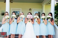 The bridesmaids on the steps of the house at Lenora's Legacy. Such pretty bouquets! Photo credit: Cureton Photography.