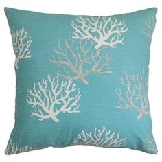 """Bring a pop of coastal charm to your sofa or favorite reading nook with this lovely cotton pillow, featuring a coastal blue-hued coral motif. Made in the USA.    Product: PillowConstruction Material: Cotton cover and feather-down fillColor: Coastal blueFeatures:  Insert includedHidden zipper closureMade in the USA Dimensions: 18"""" x 18""""Cleaning and Care: Spot clean"""